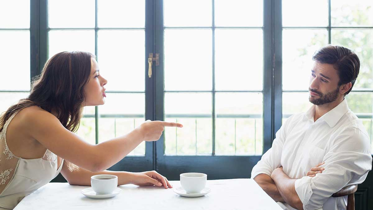 Couple-Arguing-At-Table-Before-Counseling