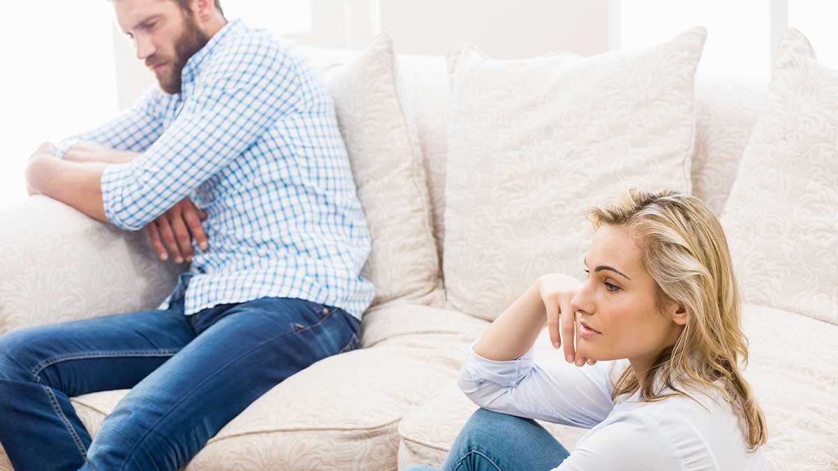 unhappy couple in need of couples counseling